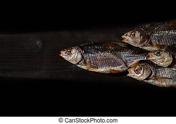 Dried or jerky salted taranka, tasty clipfish on wooden ...