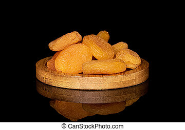 Dried orange apricot isolated on black glass - Lot of whole ...