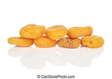 Dried orange apricot isolated on white - Group of seven ...