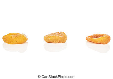 Dried orange apricot isolated on white - Group of three ...