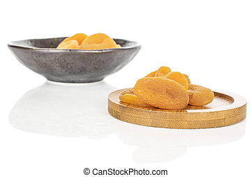 Dried orange apricot isolated on white - Lot of whole dried ...