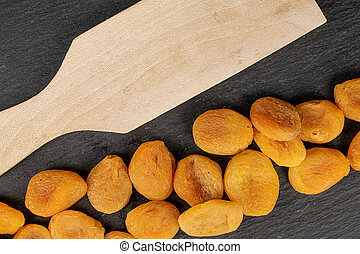 Dried orange apricot on grey stone - Lot of whole dried ...