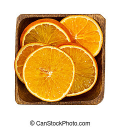 Dried orange slices in wooden bowl