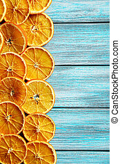 Dried orange slices on a blue wooden table