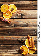 Dried orange slices on a brown wooden table