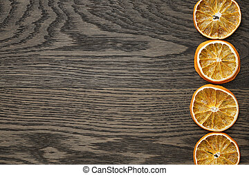 dried orange slices on dark oak table
