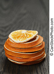 dried orange slices on old table