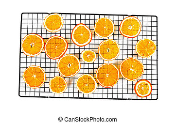 Dried orange slices on rack isolated on white background.