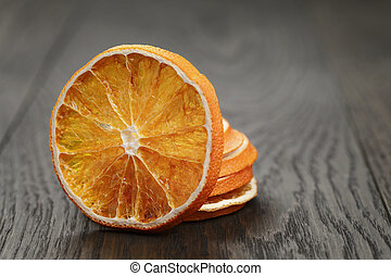 dried orange slices, on wood table