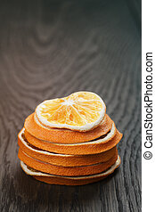 dried orange slices on wood table