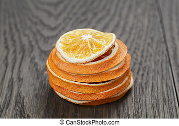 dried orange slices with anise star, on wood table