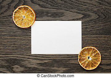 dried orange slices with paper card