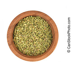 Dried Oregano in wooden bowl on white background Top view