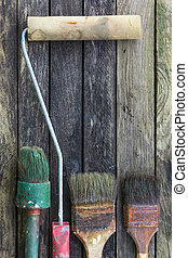 Dried paint in old brush for repair. - Vintage tools on a...