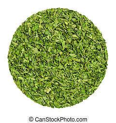 Dried parsley. Herb circle from above, isolated, over white. Disc made of chopped garden parsley, also petersilie. Petroselinum crispum. Green herb, spice and vegetable. Closeup. Macro food photo