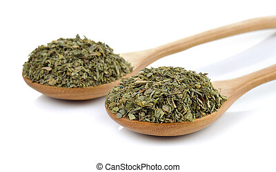 dried parsley in wooden spoon on white background