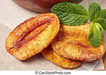 Dried peach with green leaf.