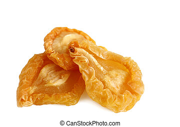 Dried Pears - Three of dried pear pieces over white...