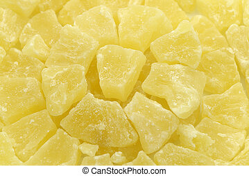 Dried pineapple dices close-up