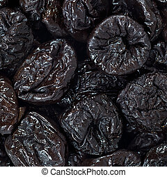 Dried plums or prunes fruit background texture pattern