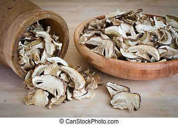 Dried porcini mushrooms on a wooden table. Rustic style. Harvest.