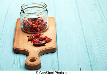 dried red pepper on a cutting board