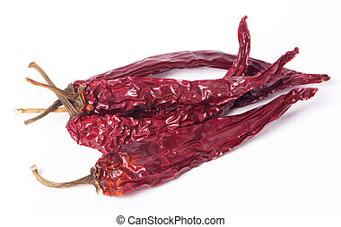 Dried red peppers on white background