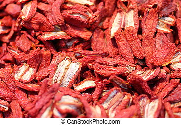 dried red tomatoes for sale in the market of Italy