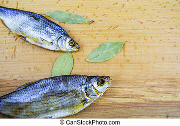Dried roach fish on a wooden cutting board - Dried fish ...