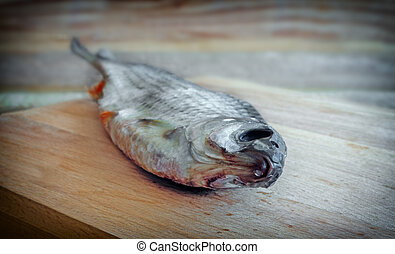 Dried roach on the table on the cutting Board. - On the ...