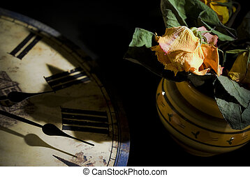 Dried rose and old style clock