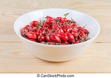 Dried rose hips in bowl at selective focus