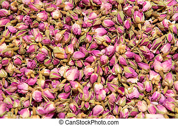 Dried rosebuds background texture