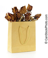 dried roses in a paper bag