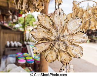 Dried salted fish selling at Thai local market