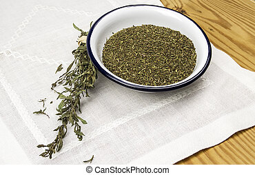 Dried savory in a white bowl