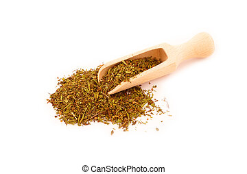 Dried savory on wooden spoon