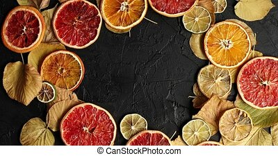 Dried slices of citrus fruit and leave - From above shot of...
