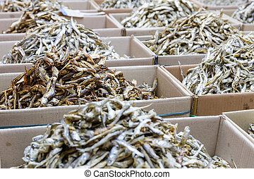 Dried small anchovy fish in the paper box