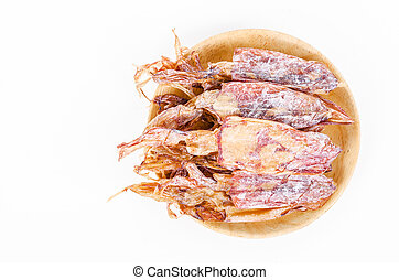 Dried squid in wooden dish.
