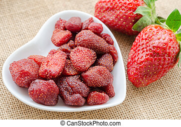Dried strawberries and fresh strawberries - Dried...
