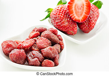 Dried strawberries in white bowl. - Dried strawberries in...