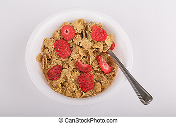 Dried Strawberries on Cereal - A bowl of toasted wheat...