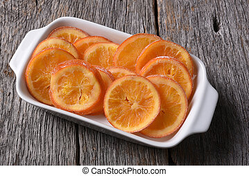 Dried Sweetened Oranges - An rectangle serving plate of...