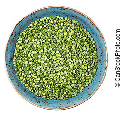 dried uncooked green peas on a plate isolated