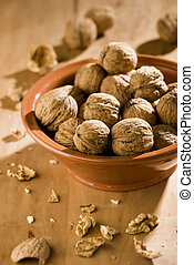 walnut - dried walnuts in a bowl close up shoot