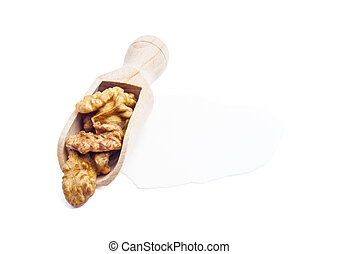 dried walnuts in wooden scoop on white background