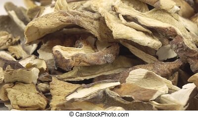 Dried white mushrooms - A pile of dry white mushrooms in...