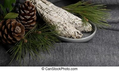 Dried white sage smudge stick, relaxation and aromatherapy. Smudging during psychic occult ceremony, herbal healing, yoga or aura cleaning. Essential incense for esoteric rituals and fortune telling.