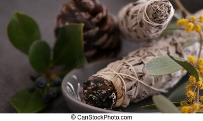 Dried white sage smudge stick, relaxation and aromatherapy. Smudging during psychic occult ceremony, herbal healing, yoga or aura cleaning. Essential incense for esoteric rituals and fortune telling